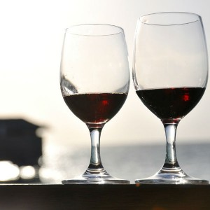 Two glasses of red wine. April is Alcohol Awareness Month and a good time to review the health effects of alcohol.